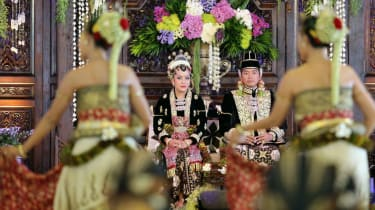 Princess Hayu watches a Javanese traditional dance with her new husband, Prince Notonegoro