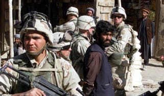 US troops of the 82nd Airborne Division question Afghan men in Kabul, Afghanistan