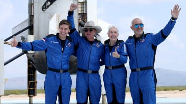 Jeff Bezos (second left) and his Blue Origin crew after flying into space