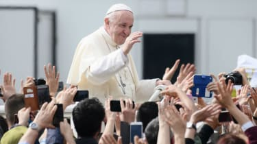 Pope Francis greets adoring crowds in Italy