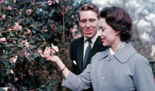 Princess Margaret and Lord Snowdon walk in Windsor Great Park on the day they announced their engagement, 27 February 1960