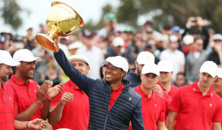 Team United States captain Tiger Woods lifts the Presidents Cup